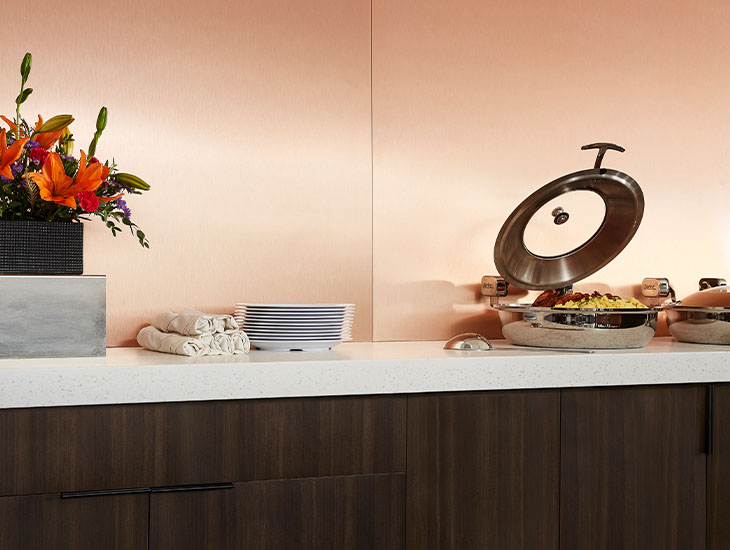 M9428 Copper Stainless metal wall panels and buffet line with 413 Tumbled Glass counter and 5790 43 Nut Brown Cherry cabinet