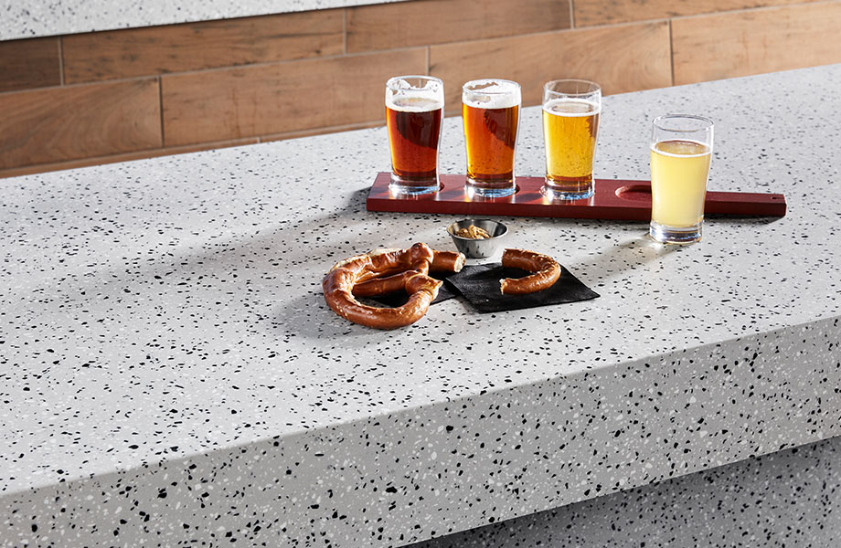 410 Argento Terrazzo Matrix gray solid surface countertop with beer and pretzel
