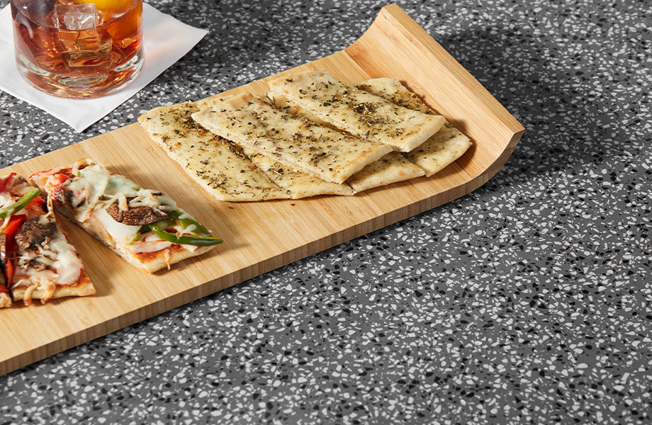 411 Grafite Terrazzo Matrix Restaurant table with appetizers and drinks