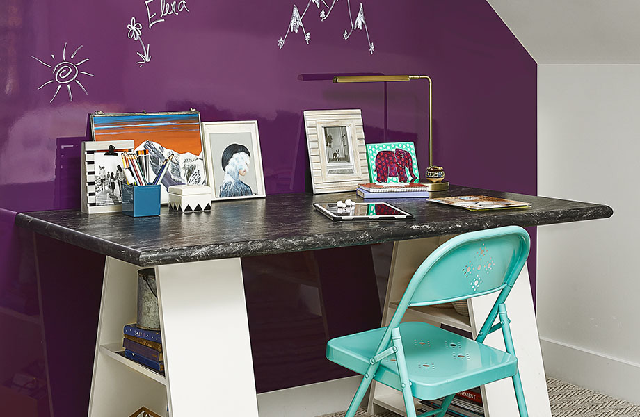 Black and white laminate desk with 5019-34 Black Bardiglio surface holds photos and paintings against 6903-90 Cassis