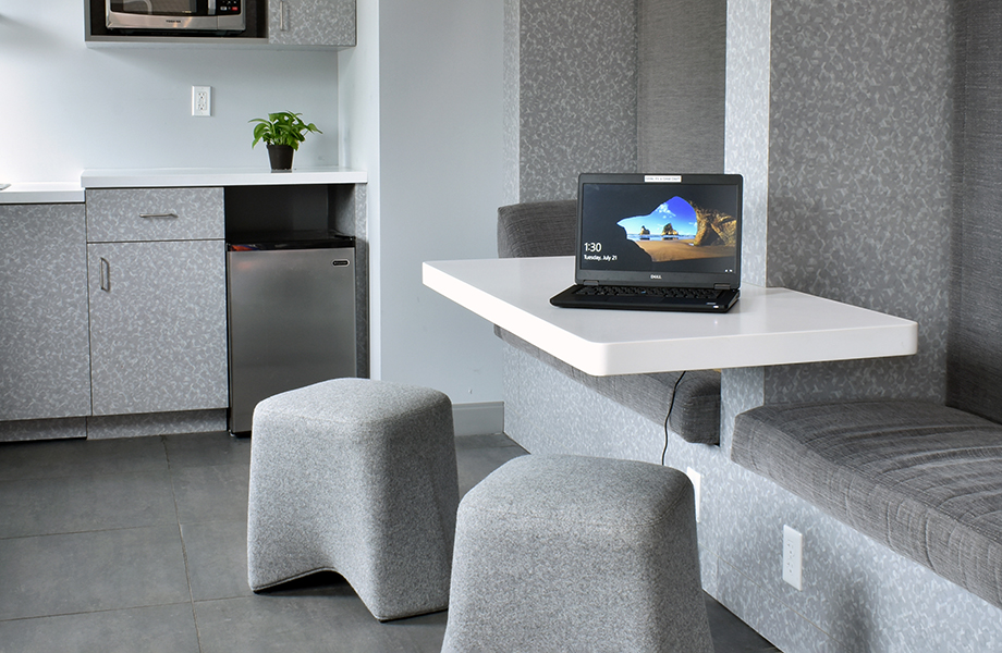 Cynthia Spray designed seating area in Folkstone Hex Formica Laminate with stools