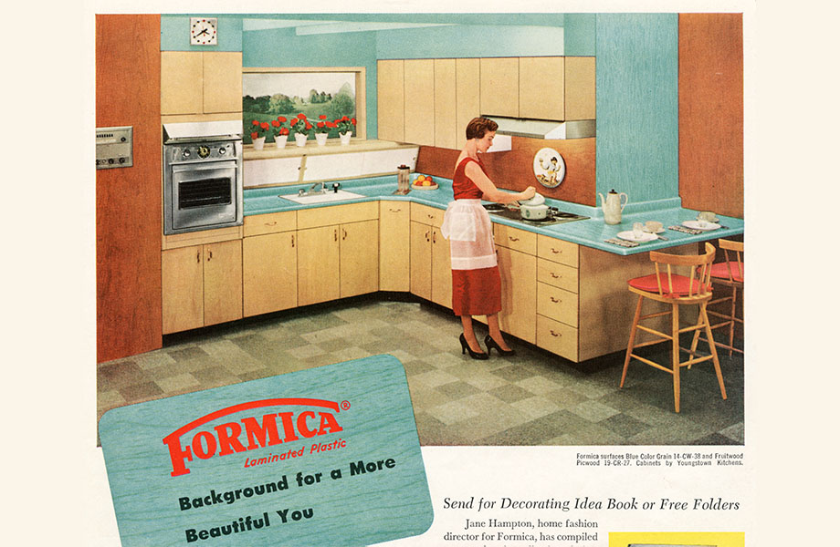 Vintage kitchen ad with woman at stove, light blue Formica laminate countertops, and woodgrain cabinets