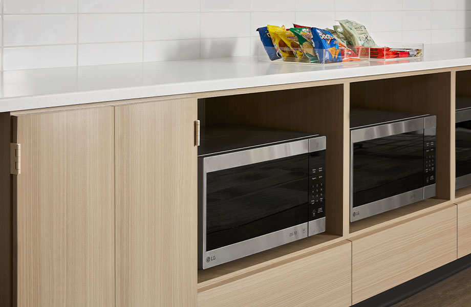 5785-NG Ashwood Beige cabinet with microwaves and 413 Tumbled Glass countertop