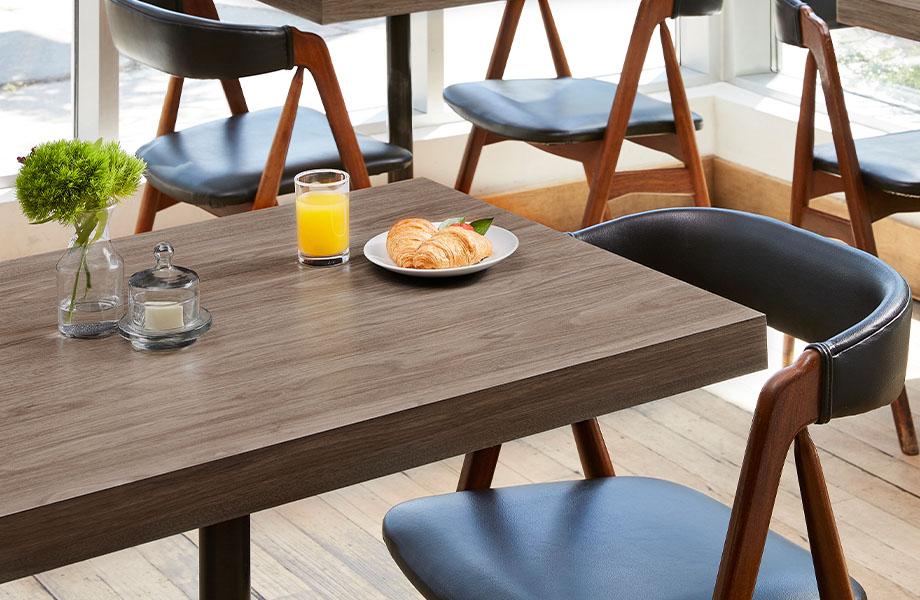 5788-NG Hazel Walnut woodgrain laminate restaurant table with breakfast