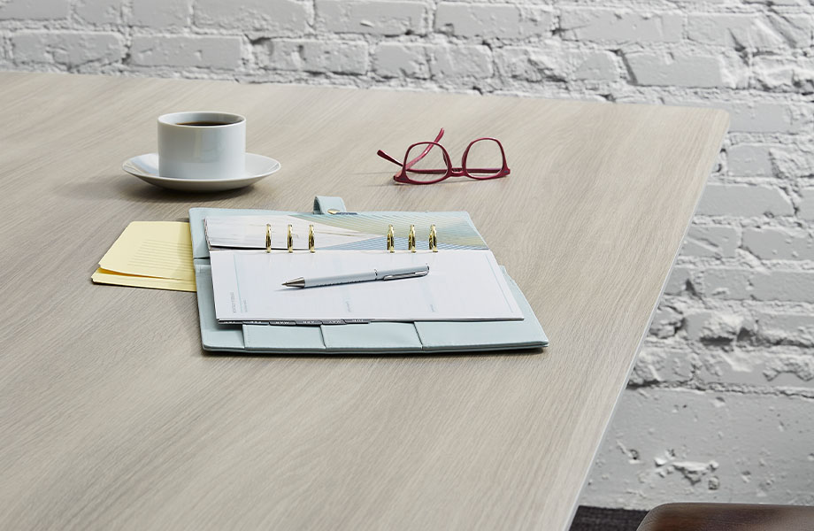5791-PG Grayed Oak wood laminate table with notebook and coffee
