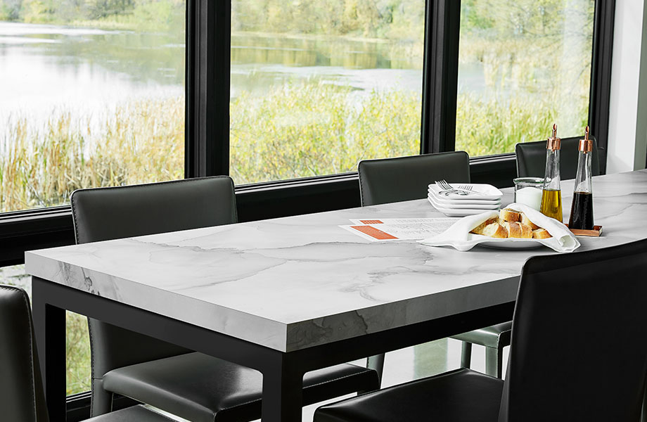 Dining room table surface made with Formica® HPL laminate 180fx® 5016-11 Watercolor Porcelain - a soft blend of gray and beige, creating pockets of colour in the translucent overlaps.