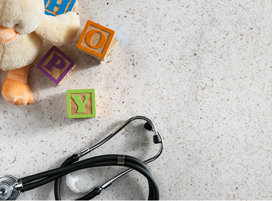 Building blocks and stethoscope 788 White Travertine Formica Solid Surfacing